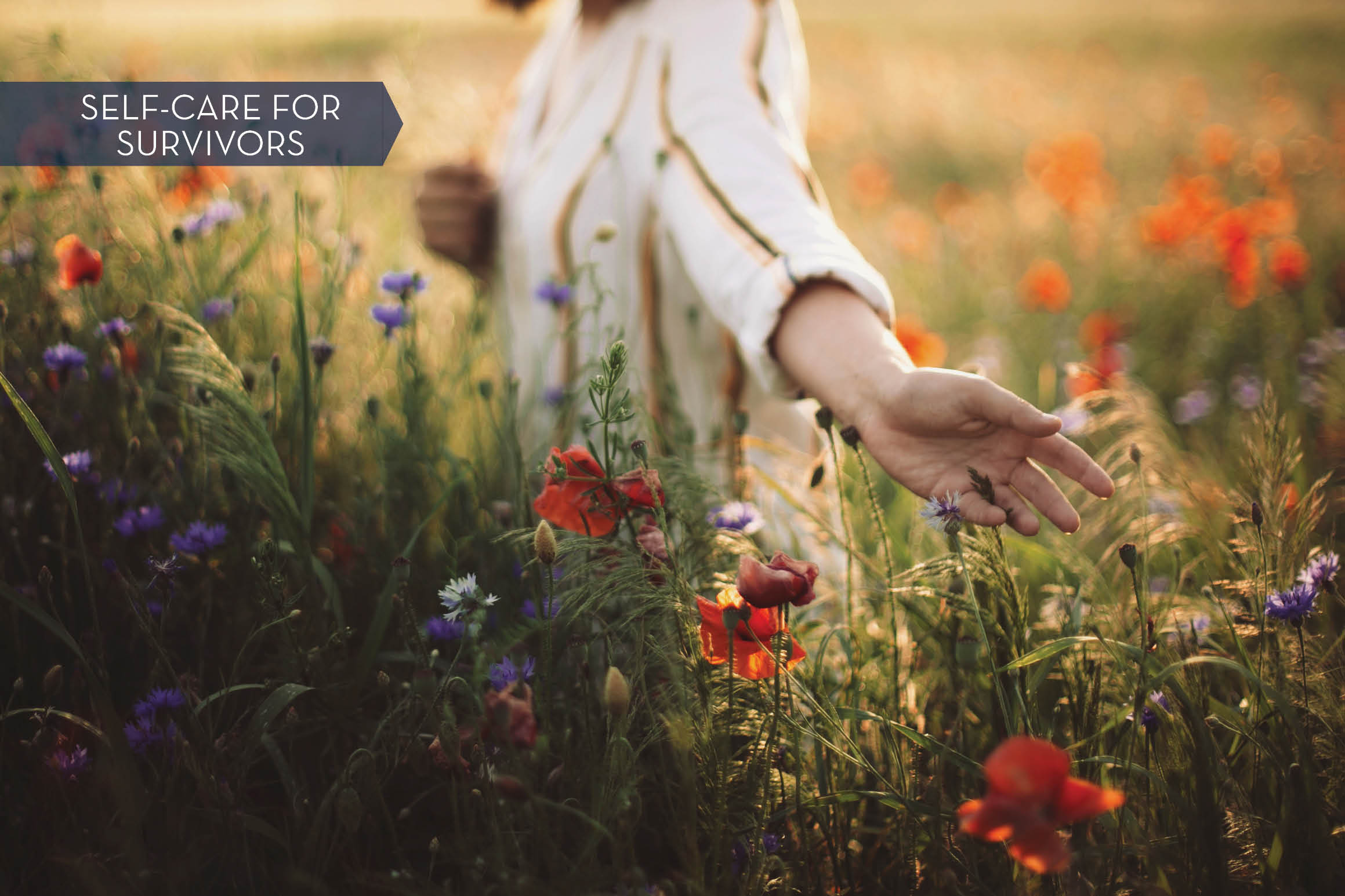 a woman walks in a field of wildflowers and reaches out to touch the flowers